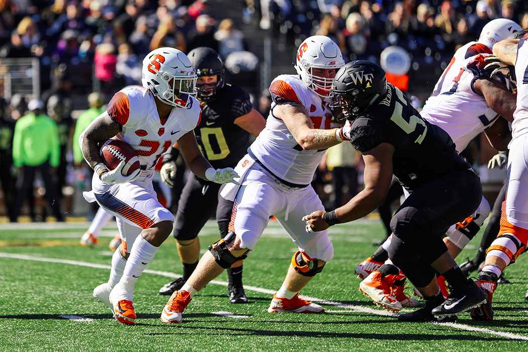 Syracuse's running back carries the ball.