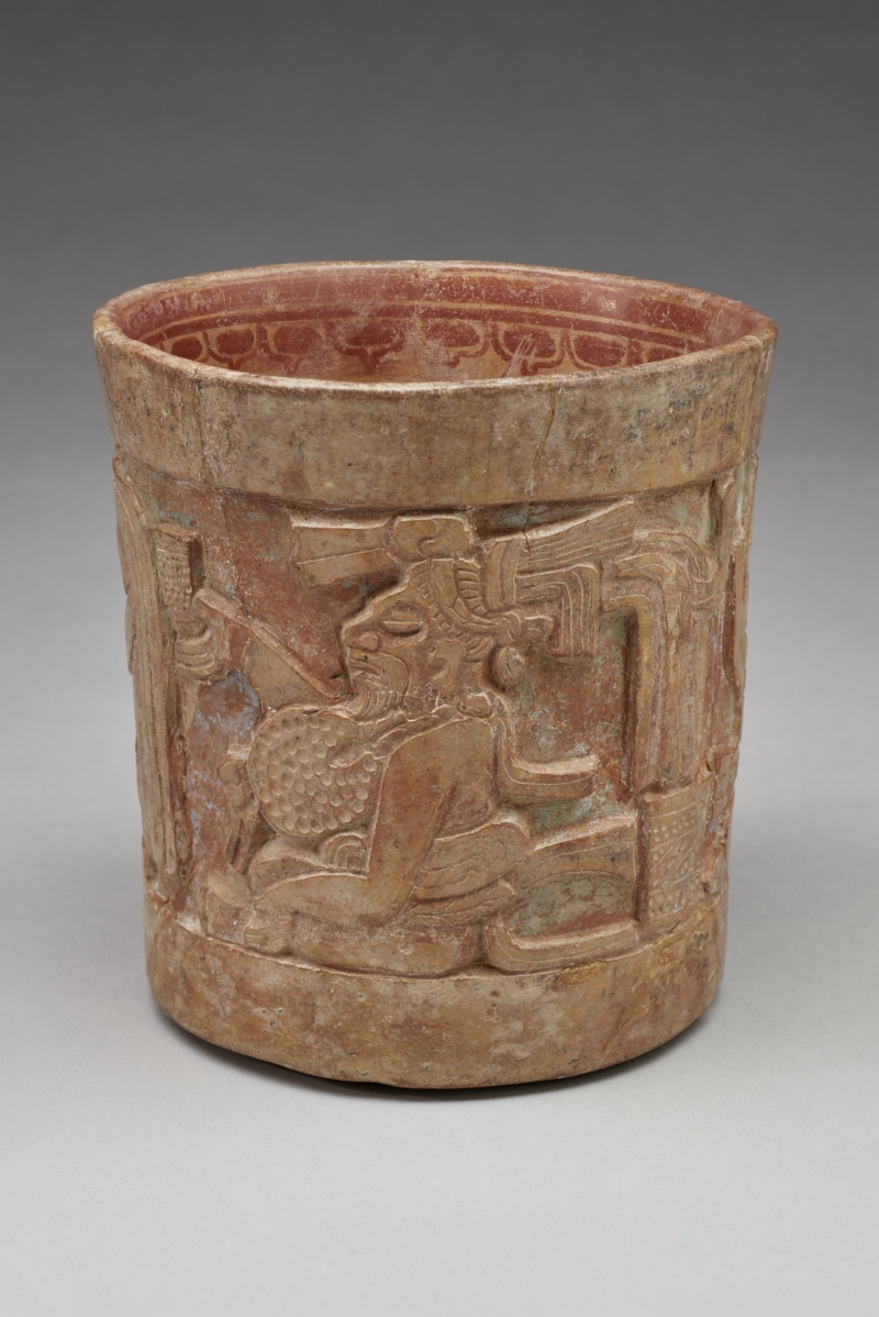 Carved Vase with Three Seated Figures