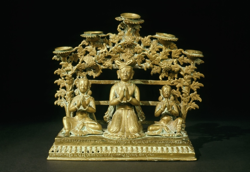 Puja Lamp with Devotees