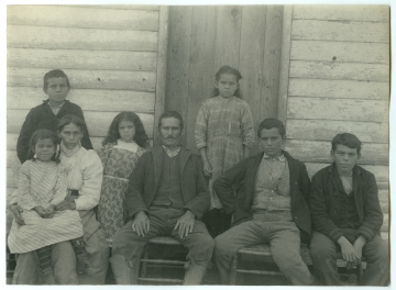 Family of Simeon Collins, Group of Eight, Near Wood Frame Building