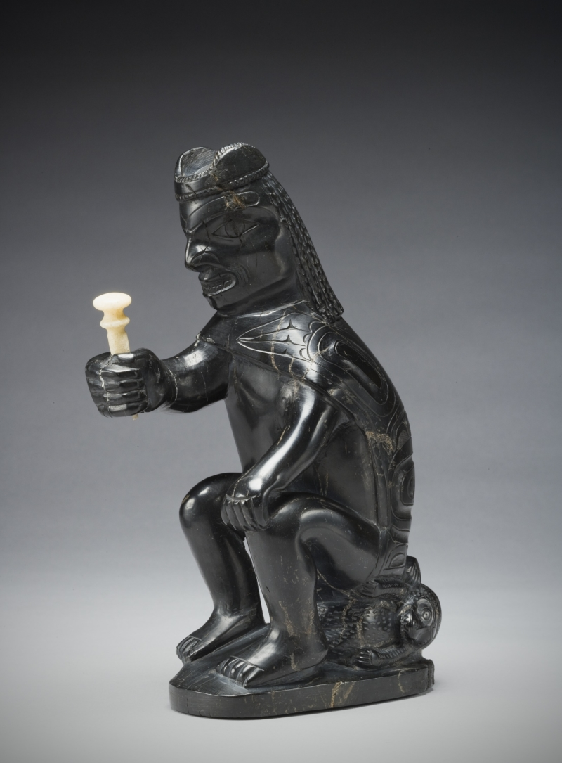 seated man figurine