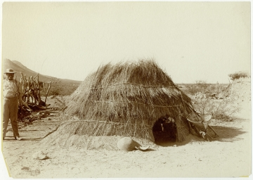 Summer Brush House with Open Roof, Man, Basket, and Carrying Basket or Kiaha Nearby