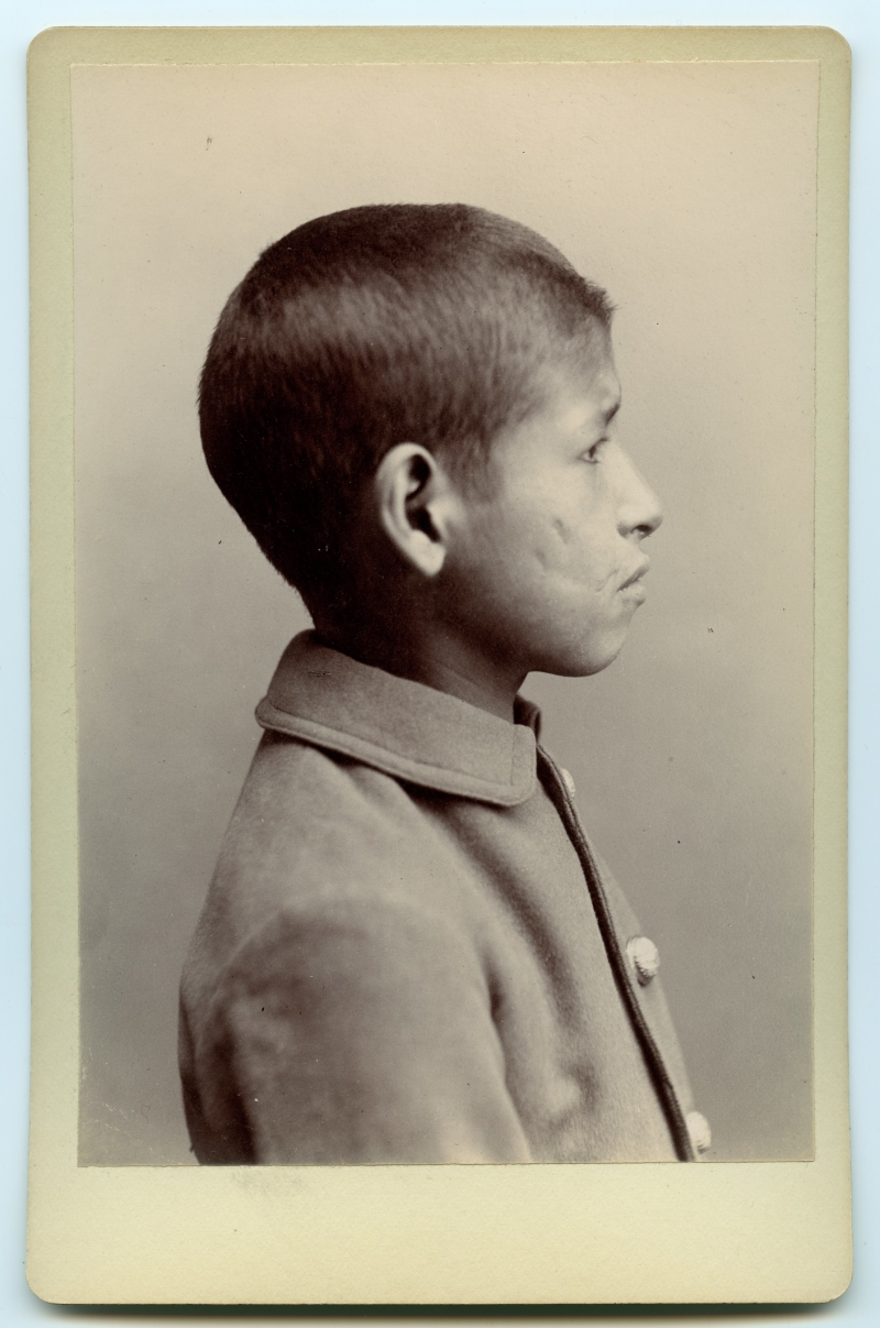 Profile portrait of boy in Indian school uniform