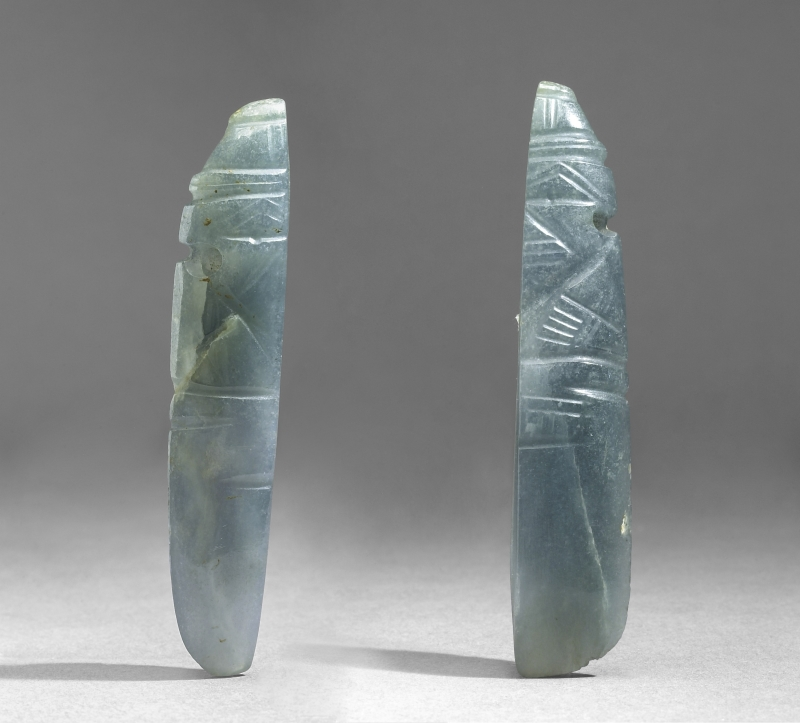 Two Figural Celt Pendants (not a pair)