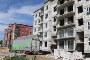 50 жил болсон барак байруудыг буулган орчин үеийн орон сууцны барилгуудыг барьсаар байна