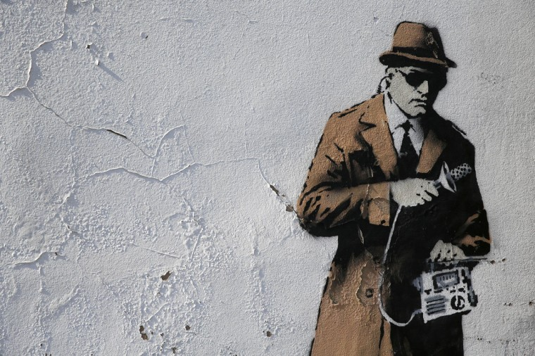 A detail from graffiti art is seen on a wall near the headquarters of Britain's eavesdropping agency, Government Communications Headquarters, known as GCHQ, in Cheltenham, western England on April 16, 2014. (REUTERS/Eddie Keogh)