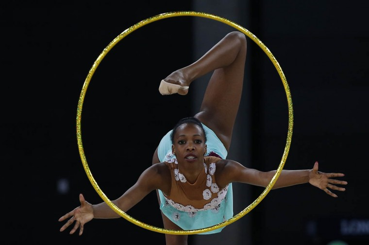 Grace Legote of South Africa performs during her hoop routine as she competes in the rhythmic gymnastics individual all-around final event at the 2014 Commonwealth Games in Glasgow, Scotland, (Phil Noble/Reuters photo)