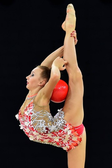 Canada's gold medalist Patricia Bezzoubenko competes in the ball discipline, during the Individual All-Around Final of the Rhythmic Gymnastics event at The SSE Hydro venue at the 2014 Commonwealth Games in Glasgow July 25, 2014. (Ben Stansall/Getty Images)