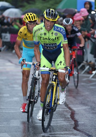 (R-L) Alberto Contador of Spain and Tinkoff-Saxo attacks Vincenzo Nibali of Italy and the Astana Pro Team in the overall race leader's yellow jersey on the climb to the finish on the Cote de la Mauselaine during stage eight of the 2014 Le Tour de France from Tomblaine to Gerardmer La Mauselaine on July 12, 2014 in Gerardmer La Mauselaine, France. Contador finished second in the stage, three seconds ahead of Nibali who finished third and retained the overall race lead. (Doug Pensinger/Getty Images)
