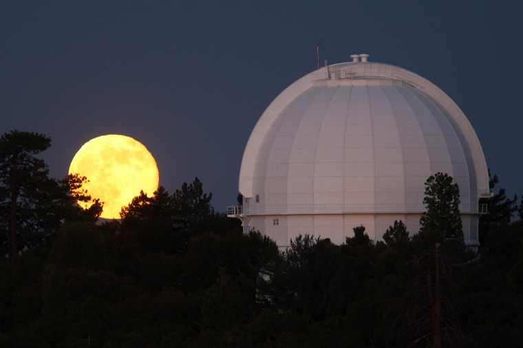 The so-called Supermoon, or perigee moon, rises behind the historic Mount Wilson Observatory on July 12, 2014 at Mount Wilson in the Angeles National Forest northeast of Los Angeles, California. The observatory founded by George Hale houses the 60-inch Hale telescope, built in 1908, and the, formerly world's largest, 100-inch Hooker telescope built in 1917. The perigree moon appears slightly brighter and larger on its closest orbits to the earth and will occur three times this year. (Photo by David McNew/Getty Images)