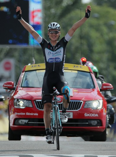 Tony Martin of Germany and the Omega Pharma - Quick-Step Cycling Team celebrates as he crosses the finish line to win stage nine of the 2014 Le Tour de France from Gerardmer to Mulhouse on July 13, 2014 in Mulhouse, France. (Doug Pensinger/Getty Images)