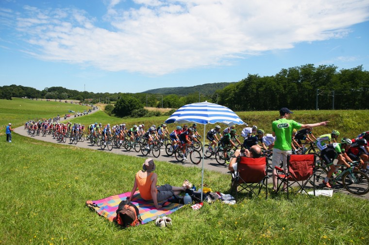 Fans roadside enjoy the atmosphere as the peloton passes by during the eleventh stage of the 2014 Tour de France, a 188km stage between Besancon and Oyonnax, on July 16, 2014 in Besancon, France. (Bryn Lennon/Getty Images)