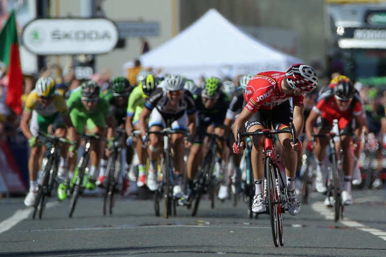 Tony Gallopin of France and Lotto Belisol looks back as the peloton closes in on his solo breakaway in the final meters as he held on to win the eleventh stage of the 2014 Tour de France, a 188km stage between Besancon and Oyonnax, on July 16, 2014 in Oyonnax, France. (Doug Pensinger/Getty Images)