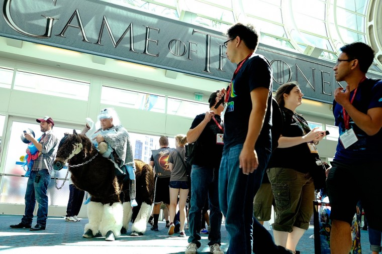 "Karl Zingheim (L) of San Diego prepares to showcase his ""White Walker"" costume, complete with undead horse, from the show ""Game of Thrones"" as he enters the San Diego Convention Center for the 45th annual San Diego Comic-Con on July 24, 2014 in San Diego, California. An estimated 130,000 attendees are expected at this year's convention, which will celebrate the 75th anniversary of both Marvel Comics and the first Batman comic book. (T.J. Kirkpatrick/Getty Images)"