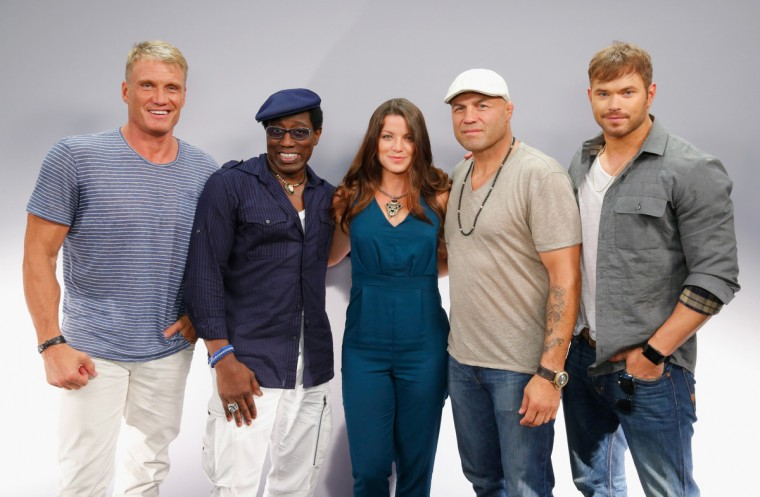 "(L-R) Actors Dolph Lundgren, Wesley Snipes, TV personality Camille Ford, actors Randy Couture and Kellan Lutz attend ""The Expendables 3"" Movies on Demand Interview session at Hard Rock Hotel San Diego on July 24, 2014 in San Diego, California. (Joe Scarnici/Getty Images for iN DEMAND)"