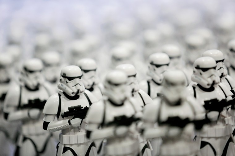 An army of Stormtrooper figurines stands on display in an exhibitor booth during the 45th annual San Diego Comic-Con on July 24, 2014 in San Diego, California. An estimated 130,000 attendees are expected at this year's convention, which will celebrate the 75th anniversary of both Marvel Comics and the first Batman comic book. (T.J. Kirkpatrick/Getty Images)