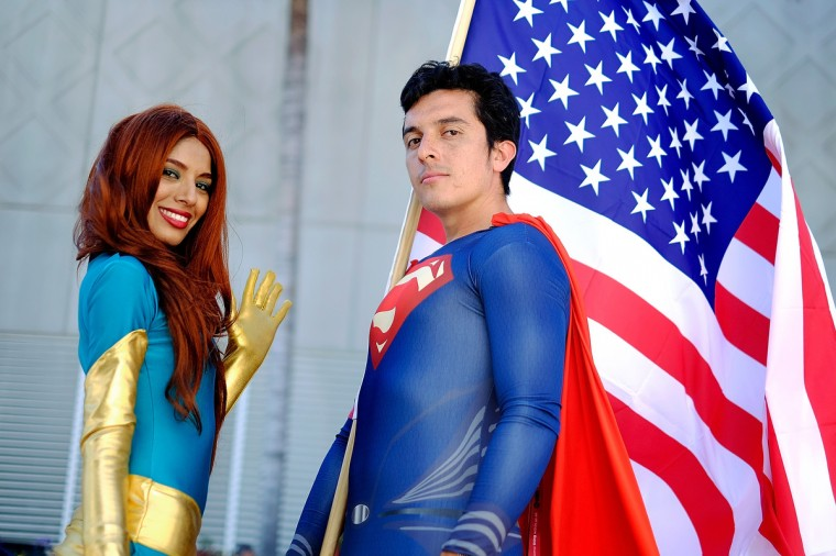 Belinda Sainz, left, and Bersain Gutierrez, both of San Diego, CA, portray the characters Phoenix and Superman during the 45th annual San Diego Comic-Con on July 24, 2014 in San Diego, California. An estimated 130,000 attendees are expected at this year's convention, which will celebrate the 75th anniversary of both Marvel Comics and the first Batman comic book. (T.J. Kirkpatrick/Getty Images)