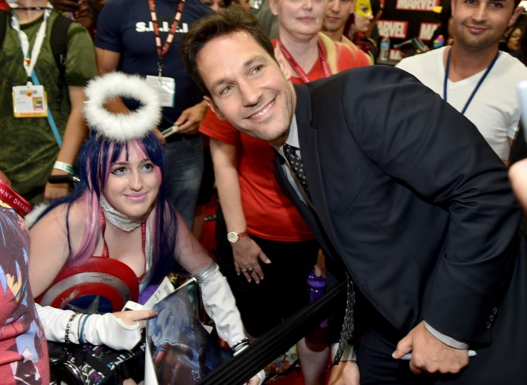 "Actor Paul Rudd (R) attends Marvel's ""Ant-Man"" Hall H Panel Booth Signing during Comic-Con International 2014 at San Diego Convention Center on July 26, 2014 in San Diego, California. (Alberto E. Rodriguez/Getty Images)"