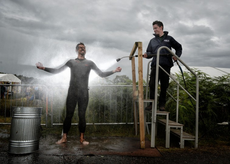 An entrant is hosed down in the 'shower cubicle' after takes part in the Irish Bog Snorkelling championship this afternoon at Peatlands Park on July 27, 2014 in Dungannon, Northern Ireland. The annual event sees male and female competitors swim the 60m length of the bog watched by scores of spectators and takes place on International Bog Day. (Charles McQuillan/Getty Images)