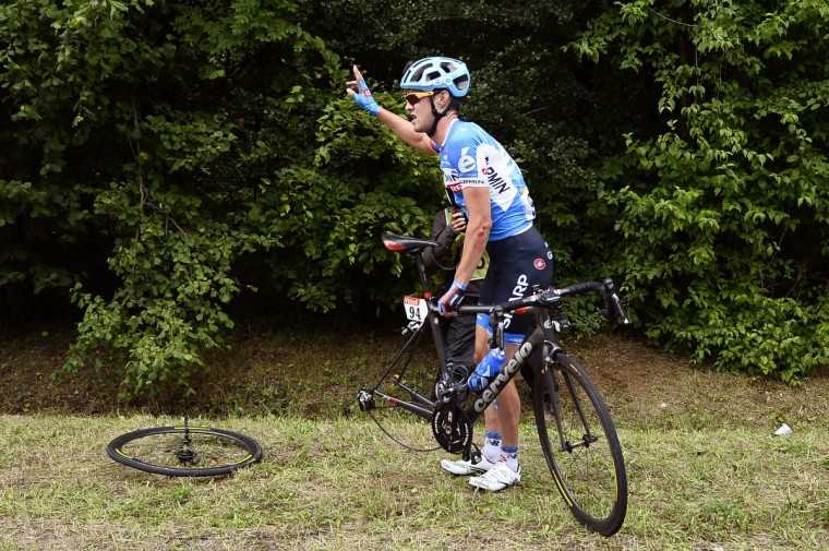 USA's Alex Howes asks assistance after a fall during the 234.5 km seventh stage of the 101st edition of the Tour de France cycling race on July 11, 2014 between Epernay and Nancy, northeastern France. (Lionel Bonaventure/Getty Images)