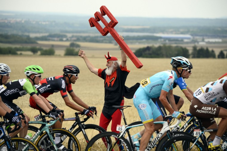 German fan Didi Senft known as El Diablo cheers as the pack rides past during the 234.5 km seventh stage of the 101st edition of the Tour de France cycling race on July 11, 2014 between Epernay and Nancy, northeastern France. (Lionel Bonaventure/Getty Images)