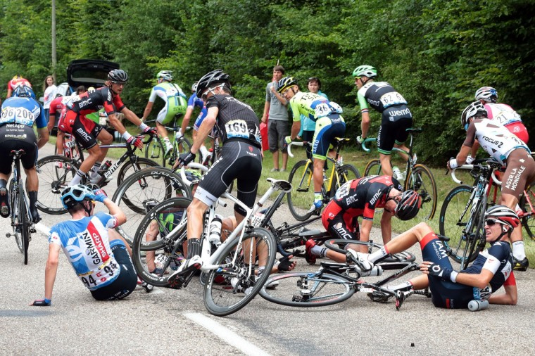 (From L) USA's Alex Howes, Spain's Haimar Zubeldia, USA's Tejay Van Garderen, Netherlands' Tom Jelte Slagter are pictured after a fall during the 234.5 km seventh stage of the 101st edition of the Tour de France cycling race on July 11, 2014 between Epernay and Nancy, northeastern France. (Fred Mons/Getty Images)