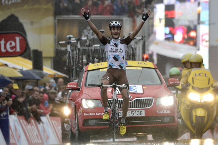 France's Blel Kadri celebrates as he crosses the finish line at the end of the 161 km eighth stage of the 101st edition of the Tour de France cycling race on July 12, 2014 between Tomblaine and Gerardmer La Mauselaine, eastern France. (Jeff Pachoud/Getty Images)