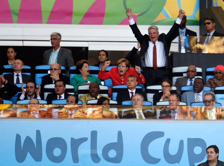 German Chancellor Angela Merkel (2R) and German Prime Minsiter Joachim Gauck (R) celebrate a disallowed goal as Brazilian President Dilma Roussef (C) watches on during the first half of the 2014 FIFA World Cup final football match between Germany and Argentina at the Maracana Stadium in Rio de Janeiro, Brazil, on July 13, 2014. (Odd Andersen/Getty Images)