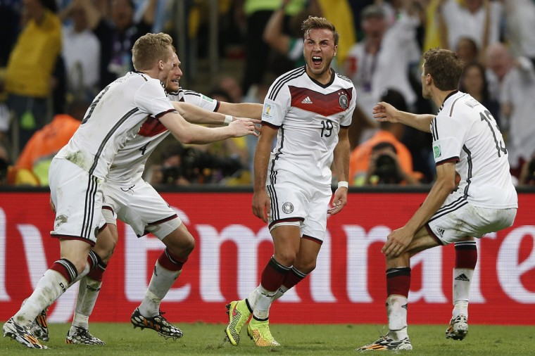 Germany's forward Mario Goetze (C) celebrates after scoring during the final football match between Germany and Argentina for the FIFA World Cup at The Maracana Stadium in Rio de Janeiro on July 13, 2014. (Adrian Dennis/Getty Images)