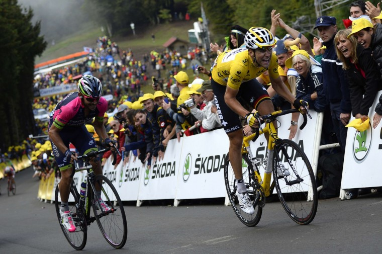 France's Tony Gallopin wearing the overall leader's yellow jersey rides during the 161.50 km tenth stage of the 101st edition of the Tour de France cycling race on July 14, 2014 between Mulhouse and La Planche des Belles Filles ski resort, eastern France. (Lionel Bonaventure/Getty Images)