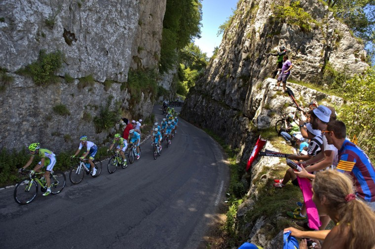 The pack rides during the 187.5 km eleventh stage of the 101st edition of the Tour de France cycling race on July 16, 2014 between Besancon and Oyonnax, eastern France. (Lionel Bonaventure/Getty Images)
