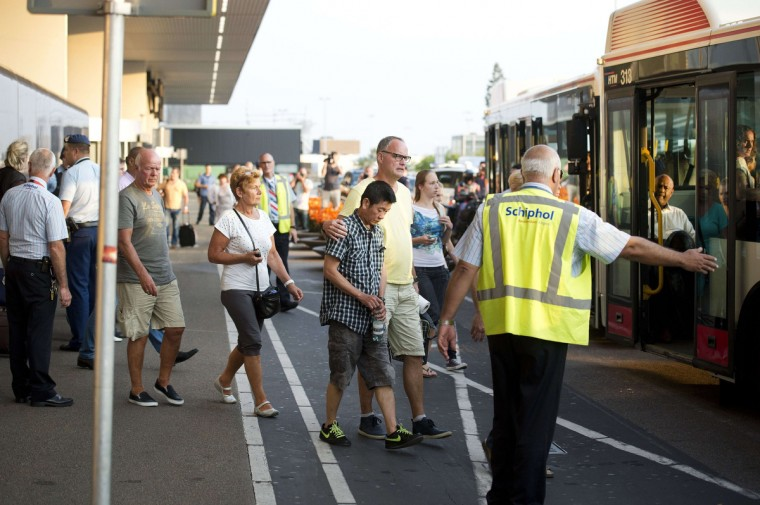 "Relatives of passengers of Malaysia Airlines flight MH17 get onto a bus at Schiphol Airport near Amsterdam, the Netherlands, on July 17, 2014, headed for an unkown destination after they received additional information about the Malaysia Airlines plane traveling from Amsterdam to Kuala Lumpur that crashed near the town of Shaktarsk, in rebel-held east Ukraine. A Malaysian airliner carrying 295 people from Amsterdam to Kuala Lumpur crashed on July 17 in rebel-held east Ukraine, as Kiev said the jet was shot down in a ""terrorist"" attack. Ukraine's government and pro-Russian insurgents traded blame for the disaster, with comments attributed to a rebel commander suggesting his men may have downed Malaysia Airlines flight MH17 by mistake, believing it was a Ukrainian army transport plane. (Olaf Kraak/Getty Images)"