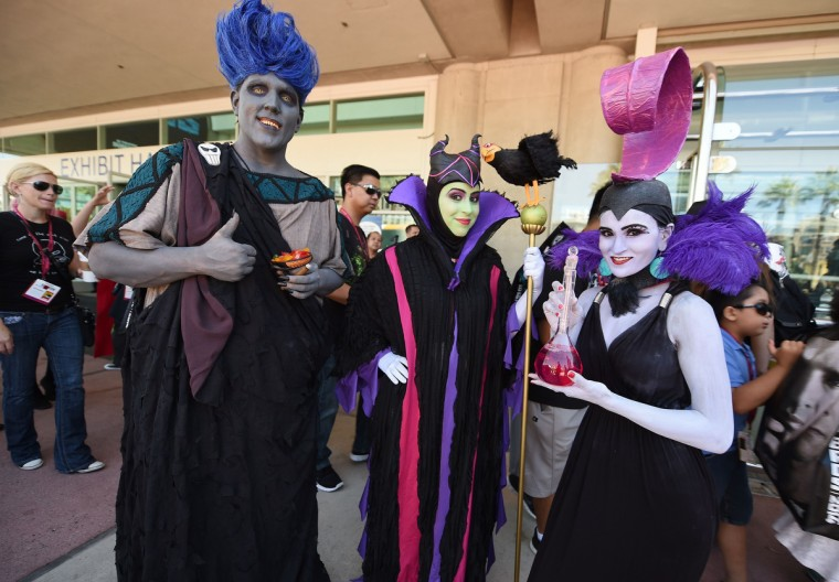 Attendees dressed as Disney villains, from left, Hades, Maleficent and Yzma attend the first day of the 45th annual San Diego Comic-Con, in San Diego California July 24, 2014. The four-day pop culture extravaganza celebrates film, TV, video games, comic books, costumes and other popular arts. More than 150,000 fans are expected to attend the sold-out event. (Robyn Beck/Getty Images)
