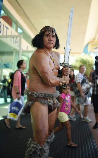 Mario Briones dressed as Conan The Destroyer attends the first day of the 45th annual San Diego Comic-Con, in San Diego California July 24, 2014. The four-day pop culture extravaganza celebrates film, TV, video games, comic books, costumes and other popular arts. More than 150,000 fans are expected to attend the sold-out event. (Robyn Beck/Getty Images)