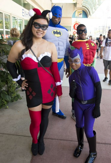 Linda Tran (L) , dressed as Harley Quinn, poses with her boyfriend Erien Hodge (back L) dressed as Batman and Hodges son Adonis (back R), 13, and daugther Alexis (R), 8, dressed as Cat Woman, on the first day of the 45th annual San Diego Comic-Con, in San Diego California July 24, 2014. The four-day pop culture extravaganza celebrates film, TV, video games, comic books, costumes and other popular arts. More than 150,000 fans are expected to attend the sold-out event. (Robyn Beck/Getty Images)