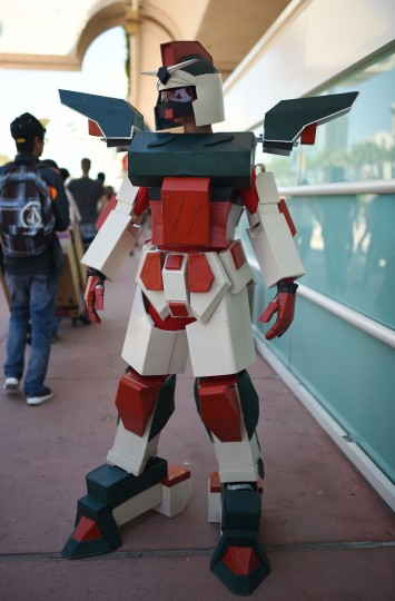Sam Joseph, 11, wears a Gundam Mecha costume, homemade from plastic sheets, on the first day of the 45th annual San Diego Comic-Con, in San Diego California July 24, 2014. The four-day pop culture extravaganza celebrates film, TV, video games, comic books, costumes and other popular arts. More than 150,000 fans are expected to attend the sold-out event. (Robyn Beck/Getty Images)