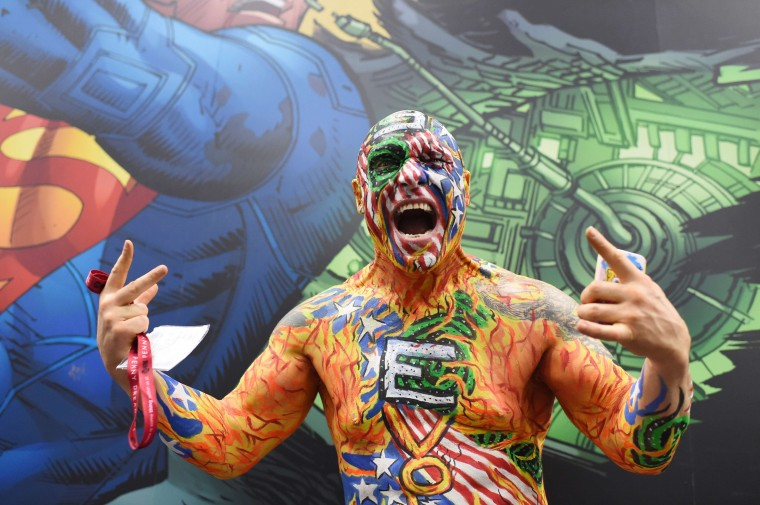 """An attendee called """"Nomad"""" of the group Dive Bomber poses on the first day of the 45th annual Comic-Con in San Diego, California on July 24, 2014 at the San Diego Convention Center. The four-day pop culture extravaganza celebrates film, TV, video games, comic books, costumes and other popular arts. More than 150,000 fans were expected to attend the sold-out event. (Robyn Beck/AFP/Getty Images)"""
