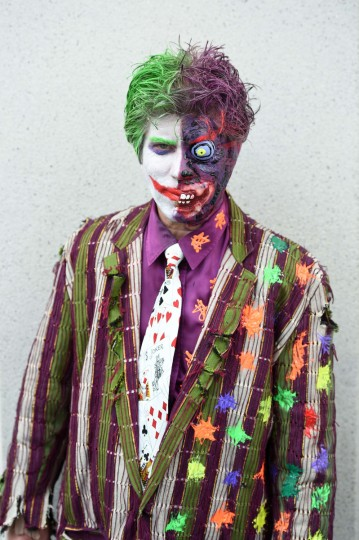 Attendee George Koutsikides is dressed as a combination of the two Batman villains Two-Face and The Joker, at the San Diego Convention Center on the third day of the 45th annual Comic-Con, in San Diego, California July 26, 2014. (Robyn Beck/Getty Images)