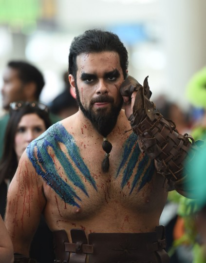 "An attendee dressed as a character from ""Game Of Thrones"" uses his mobile phone at the San Diego Convention Center on the third day of the 45th annual Comic-Con, in San Diego, California July 26, 2014. (Robyn Beck/Getty Images)"