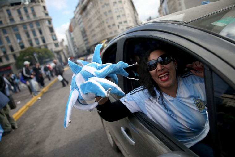 An Argentine soccer fan shows their spirit as the country waits for the start of the World Cup final on July 13, 2014 in Buenos Aires, Argentina. Argentina, a two time World Cup winner, will play against Germany in Rio de Janeiro, Brazil today for the World Cup trophy. (Joe Raedle/Getty Images)