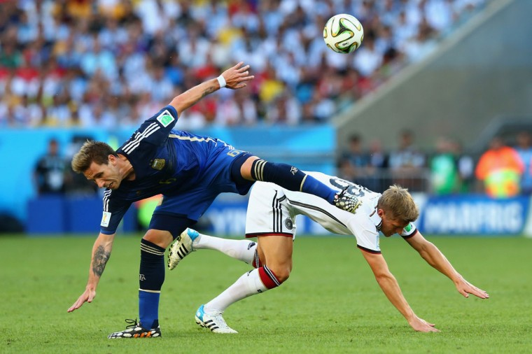 Lucas Biglia of Argentina collides with Toni Kroos of Germany during the 2014 FIFA World Cup Brazil Final match between Germany and Argentina at Maracana on July 13, 2014 in Rio de Janeiro, Brazil. (Martin Rose/Getty Images)