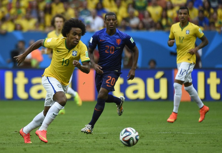 Brazil's midfielder Willian (L) and Netherlands' midfielder Georginio Wijnaldum vie during the third place play-off football match between Brazil and Netherlands during the 2014 FIFA World Cup at the National Stadium in Brasilia on July 12, 2014. (Odd Andersen/AFP/Getty Images)