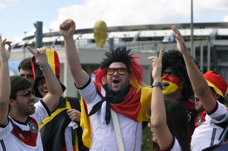Germany fans cheer prior to the 2014 FIFA World Cup final football match between Germany and Argentina at the Maracana Stadium in Rio de Janeiro, Brazil on July 13, 2014. (Pedro Ugarte/AFP/Getty Images)