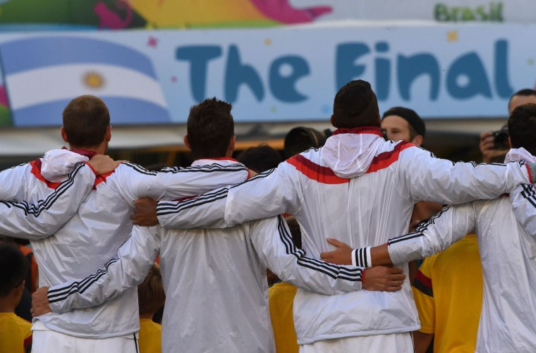 Germany's team line-up to sing their national anthem during the 2014 FIFA World Cup final football match between Germany and Argentina at the Maracana Stadium in Rio de Janeiro, Brazil, on July 13, 2014. (Pedro Ugarte/AFP/Getty Images)