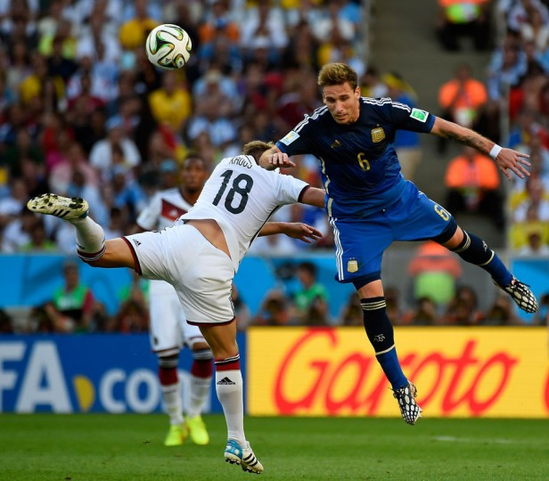 Germany's midfielder Toni Kroos (L) and Argentina's midfielder Lucas Biglia vie for the ball during the 2014 FIFA World Cup final football match between Germany and Argentina at the Maracana Stadium in Rio de Janeiro, Brazil, on July 13, 2014. AFP (Odd Andersen/AFP/Getty Images)