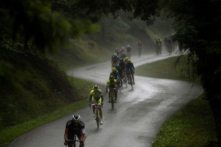 Spain's Alberto Contador (2nd front) rides in the pack during the 161.50 km tenth stage of the 101st edition of the Tour de France cycling race on July 14, 2014 between Mulhouse and La Planche des Belles Filles ski resort, eastern France. (AFP PHOTO/Lionel Bonaventure)