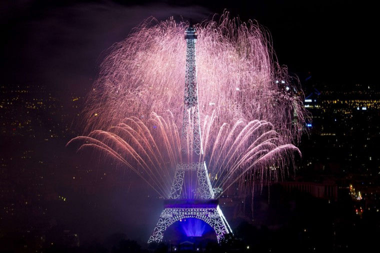 Fireworks burst around the Eiffel Tower in Paris on July 14, 2014 as part of France's annual Bastille Day celebrations. (AFP PHOTO/Kenzo Tribouillard)