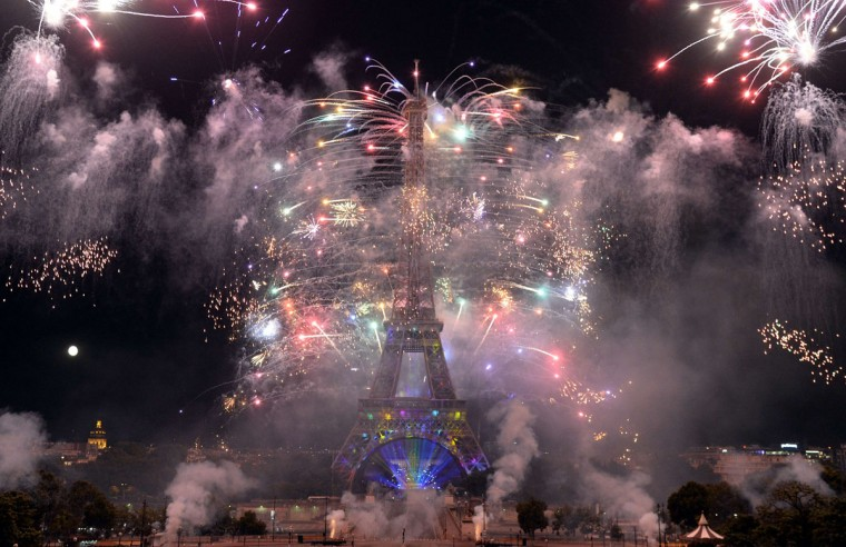 Fireworks burst around the Eiffel Tower in Paris on July 14, 2014 as part of France's annual Bastille Day celebrations. (AFP PHOTO/Pierre Andrieu)