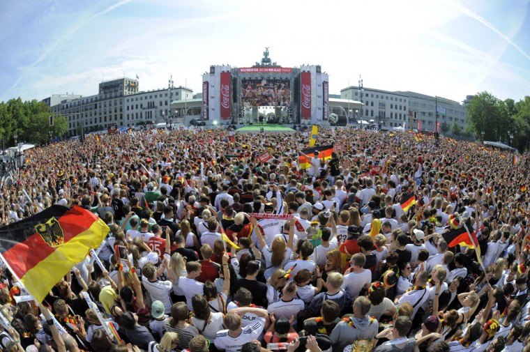 An overview taken with a fisheye lens shows German fans gather in front of a stage installed for a victory parade of Germany's football national team on July 15, 2014 at Berlin's landmark Brandenburg Gate to celebrate their FIFA World Cup title. Germany won their fourth World Cup title, after 1-0 win over Argentina on July 13, 2014 in Rio de Janeiro in the FIFA World Cup Brazil final game. (AFP PHOTO/Getty Images/Robert Michael)