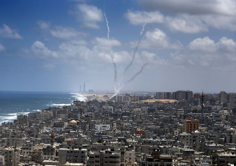 "Smoke from rockets fired from near Gaza City is seen after being launched toward Israel, on July 15, 2014. US Secretary of State John Kerry warned of the ""great risks"" that the violence between Israel and the Gaza Strip could spiral out of control. (AFP PHOTO/Getty Images/Thomas Coex)"